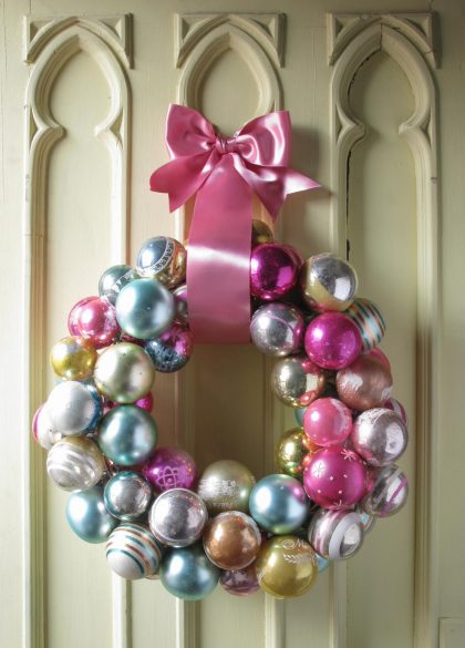 This one is my favourite. It's also the easiest to make. Take a wire hanger, form it into a circle, then untwist the hook part, string your Christmas balls, retwist the hook and voila! A super pretty Christmas ball wreath! (That everyone else will think you paid big bucks for)!.