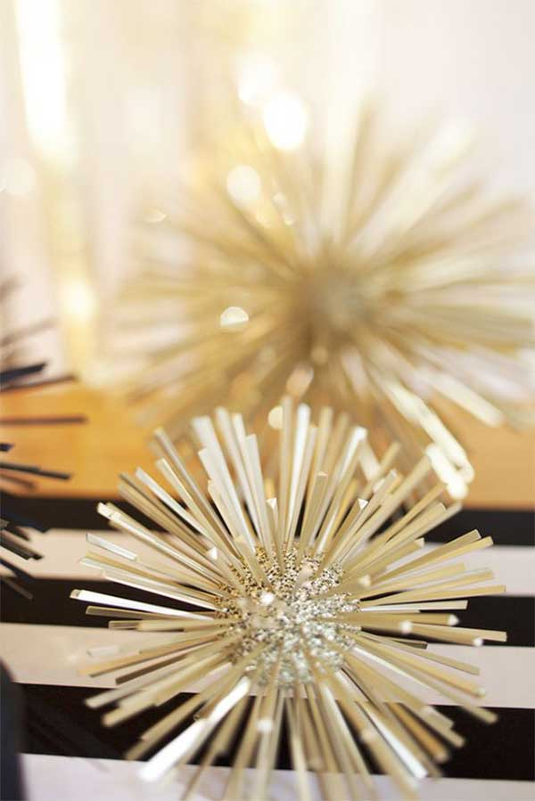 And finally, these spikey celestial balls will look awesome on a snack or dinner table, or sitting on your home bar. They're made out of small styrofoam balls, toothpicks, spraypaint and glitter. Cheap, easy, but looks great!