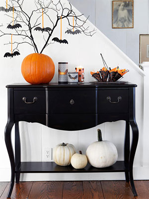 I really love the white pumpkins in this picture...they're just so much more classy looking in white! You could buy white pumpkin decorations...or just spray paint a REAL pumpkin (just don't forget to throw it out afterwards...)
