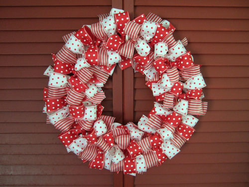 This pretty wreath is make out of ribbon. Tie a piece of ribbon into a bow around a metal ring, and repeat until the wreath is done. You can use all the pretty ribbons with Christmas patterns that the crafts stores stock this time of year :)